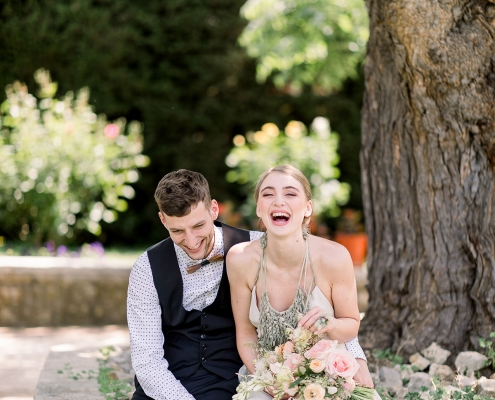 Happy couple laughing at their Croatia wedding reception at Ražnjevica Dvori A.D. 1307 by destination wedding planner Mango Muse Events
