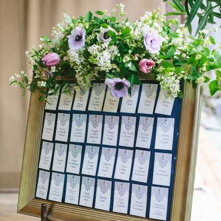 Elegant and intricate blue escort card display for a multicultural destination wedding by destination wedding planner Mango Muse Events