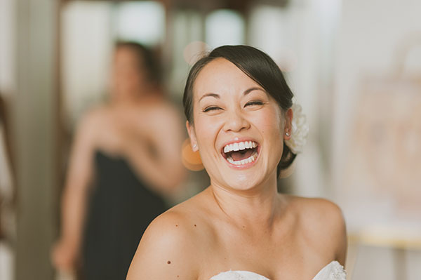 Happy laughing bride at her destination wedding in Hawaii by destination wedding planner Mango Muse Events