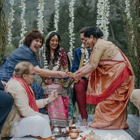 Hindu ceremony with laughing parents at a multicultural destination wedding at Calistoga Ranch by destination wedding planner Mango Muse Events
