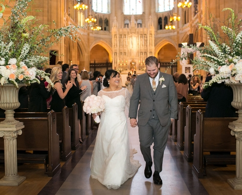 Happy couple just married at St. Dominic's Catholic Church in San Francisco by destination wedding planner Mango Muse Events