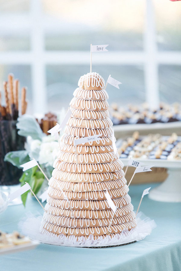 Scandinavian Kransekake wedding cake with love flags at a Sonoma wine country wedding by Destination wedding planner Mango Muse Events