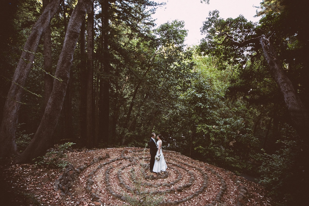 Newlywed couple moment at the madrone labyrinth circle at the Sequoia retreat center at a woodland wedding by destination wedding planner Mango Muse Events