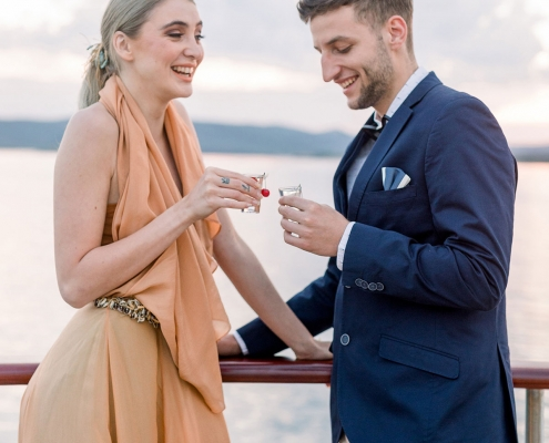 Bride and groom taking a shot of cherry liqueur at their Croatia destination wedding by destination wedding planner Mango Muse Events