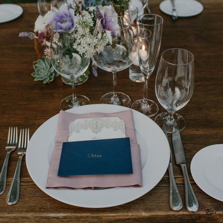 Personal hand written placecard notes for each guest at an modern elegant destination wedding by destination wedding planner Mango Muse Events