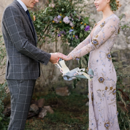 Scottish hand fasting ceremony at a destination wedding on the Isle of Skye Scotland by destination wedding planner Mango Muse Events