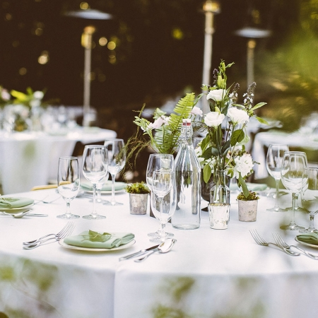 Simple wedding tablescape with a cluster of vases at a woodland wedding by destination wedding planner Mango Muse Events