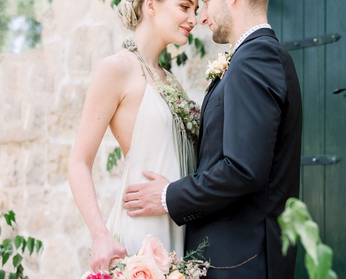 Bride and groom at their Croatia destination wedding ceremony at Ražnjevica Dvori A.D. 1307 by destination wedding planner Mango Muse Events