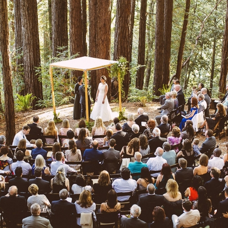 A wedding ceremony in the redwoods at the Sequoia retreat center by destination wedding planner Mango Muse Events