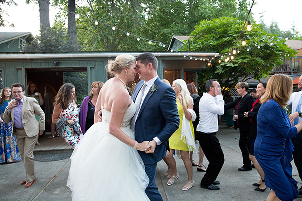 Bride and groom dancing at their destination wedding in Monte Rio by destination wedding planner Mango Muse Events