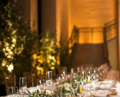 Wedding garlands and live trees decorate the Bently Reserve at a San Francisco destination wedding by destination wedding planner Mango Muse Events