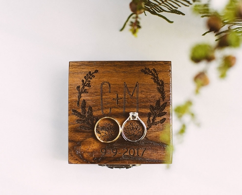 Handmade wood box and wedding rings for the ring warming ceremony at a woodland wedding by destination wedding planner Mango Muse Events