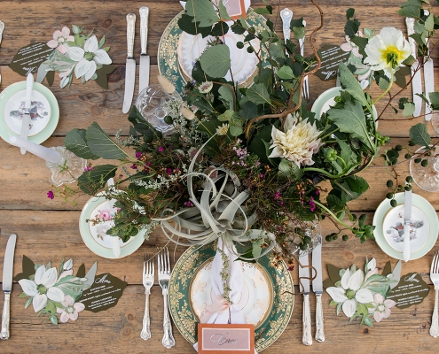 Organic foraged floral centerpiece, vintage china and hand painted stationery for a Scotland destination wedding by destination wedding planner Mango Muse Events