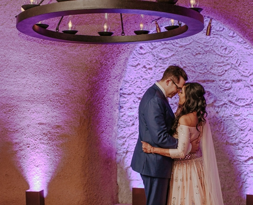 Emotional first dance in the wine cave at Calistoga Ranch for a wine country destination wedding by destination wedding planner Mango Muse Events