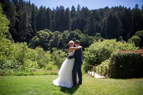 Bride groom enjoying the beautiful view at their Monte Rio russian river destination wedding by destination wedding planner Mango Muse Events