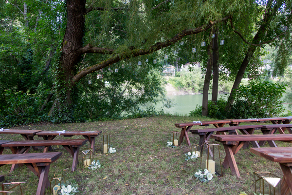 Magical russian river wedding ceremony with benches at the Rio Villa Beach Resort by destination wedding planner Mango Muse Events