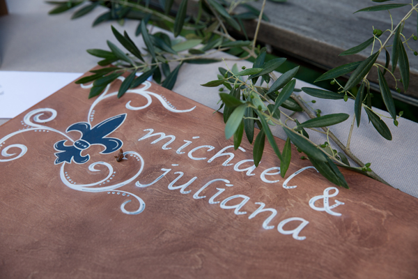 Handmade wooden guest book with fleur de lys for a rustic wedding by destination wedding planner Mango Muse Events