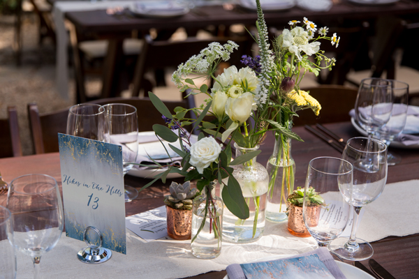 Local wild flower centerpieces in yellow and white for a russian river wedding in Monte Rio by destination wedding planner Mango Muse Events
