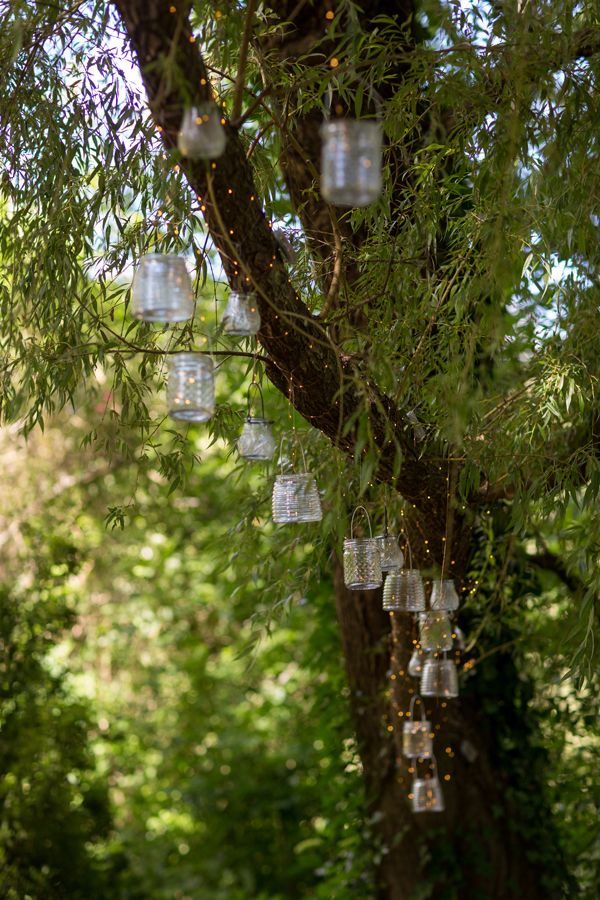 Mid-summer night's dream inspired wedding ceremony with fairy lights and hanging lanterns for a russian river wedding by destination wedding planner Mango Muse Events