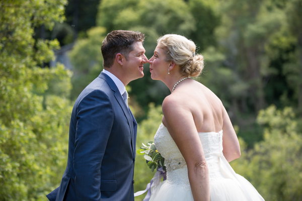 Eskimo kiss wedding moment russian river wedding in Monte Rio by destination wedding planner Mango Muse Events