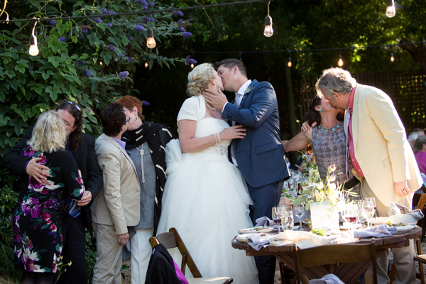 Wedding reception kiss game at a russian river wedding by destination wedding planner Mango Muse Events