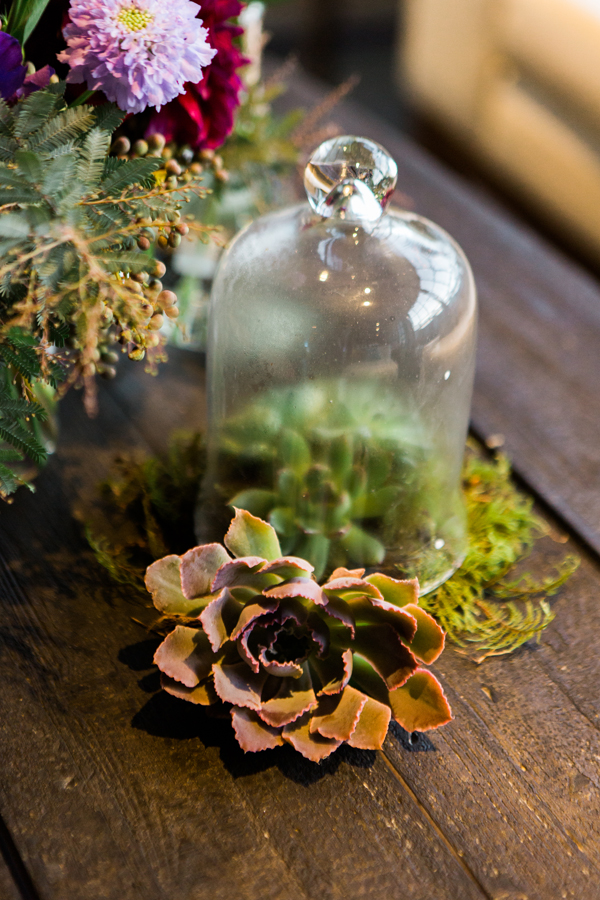Bell jar succulent wedding flower arrangement for a science wedding in San Francisco by destination wedding planner Mango Muse Events