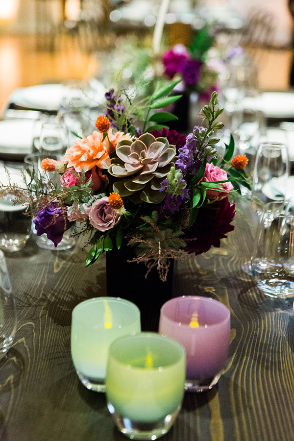 Colorful wedding centerpieces and glassybaby votives at a luxury San Francisco wedding by destination wedding planner Mango Muse Events