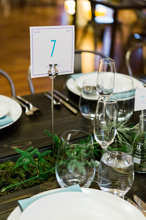Creative table numbers for a science wedding in San Francisco by destination wedding planner Mango Muse Events