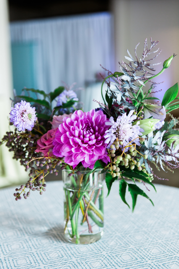 Organic purple wedding flowers in the pre-ceremony area at a Terra gallery wedding in San Francisco by destination wedding planner Mango Muse Events