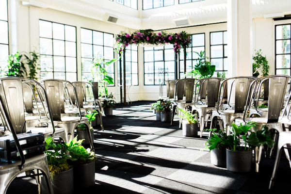 Wedding chuppah and live plants at a conservatory wedding ceremony at Terra in San Francisco by destination wedding planner Mango Muse Events