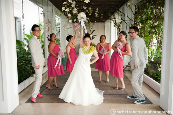 Mixed gender wedding party with bridesmen and bridesmaids at a pink wedding in Hawaii by destination wedding planner Mango Muse Events