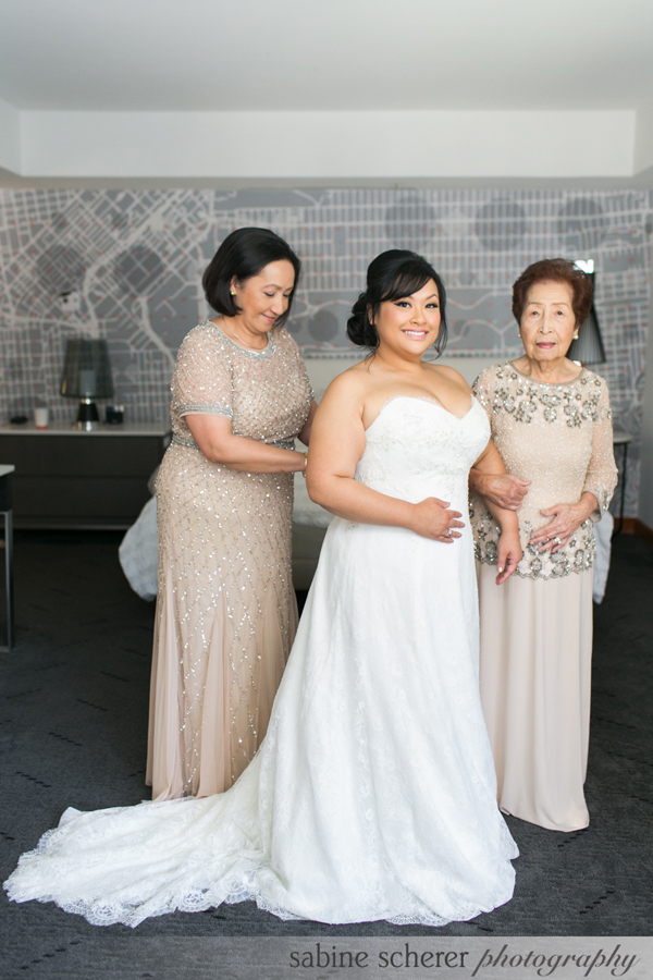 3 generations of women getting ready at a San Francisco wedding by destination wedding planner Mango Muse Events