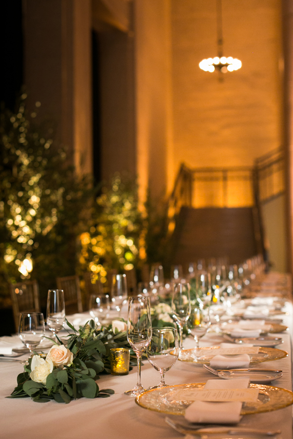 Lush garland centerpieces and live trees at a Bently Reserve wedding in San Francisco by destination wedding planner Mango Muse Events