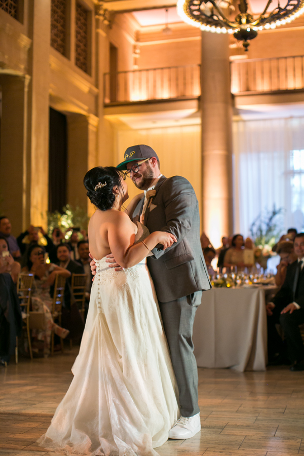 First dance in sneakers and a cap at a San Francisco wedding by destination wedding planner Mango Muse Events