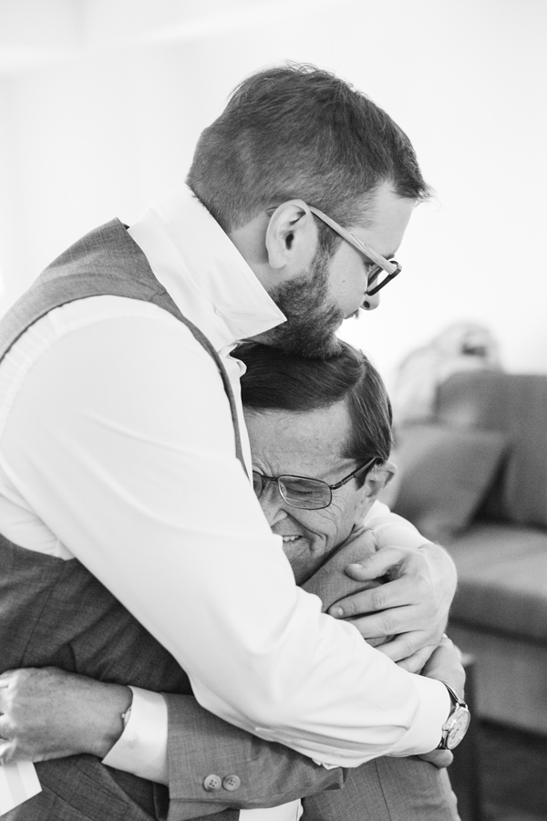 Groom and father of the groom hugging at a San Francisco destination wedding by destination wedding planner Mango Muse Events