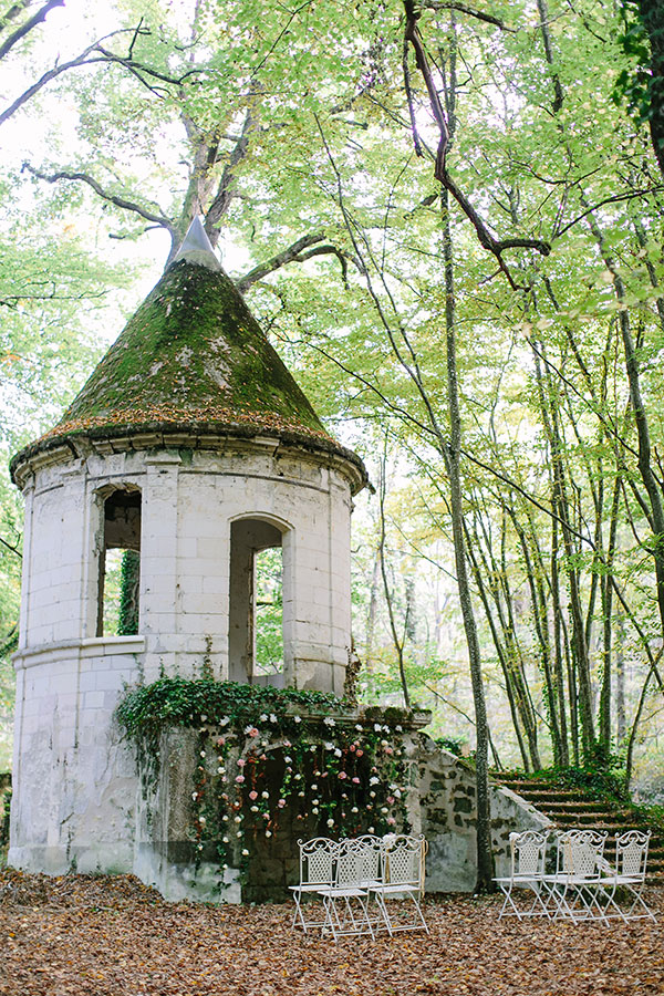 Intimate forest wedding ceremony at a France chateau wedding venue by Destination wedding planner Mango Muse Events