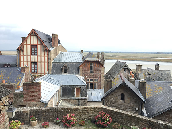 A view of the Mont St. Michel homes in France by destination wedding planner Mango Muse Events