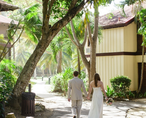 Bride and groom walking at their resort in St. Croix a destination wedding in the Caribbean by Destination wedding planner Mango Muse Events