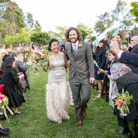 Guest cheering at a wedding ceremony at Cornerstone Sonoma by destination wedding planner Mango Muse Events