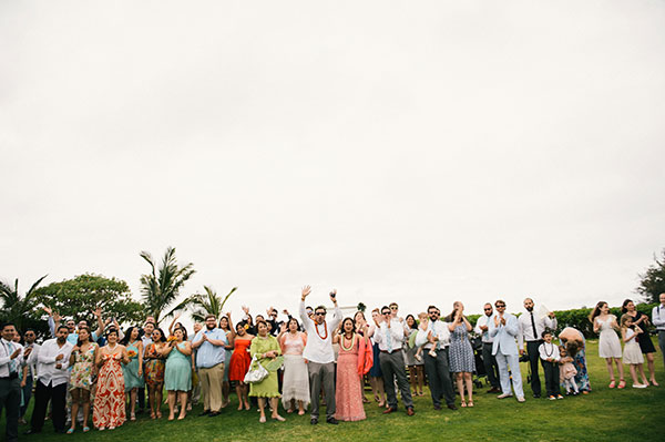 Excited wedding guests waiting for the newlyweds at a Hawaii destination wedding by destination wedding planner Mango Muse Events