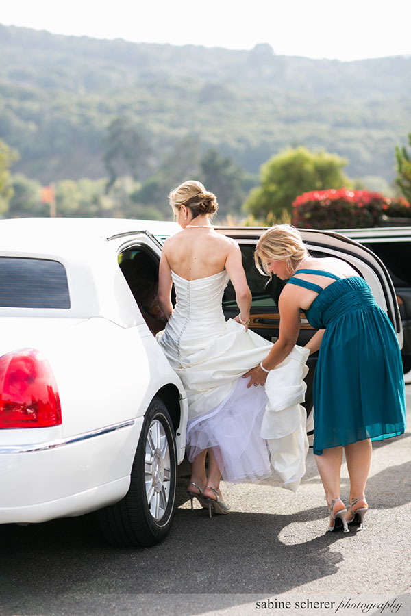 Maid of honor helping the bride get into the wedding limo at a Carmel destination wedding by destination wedding planner Mango Muse Events