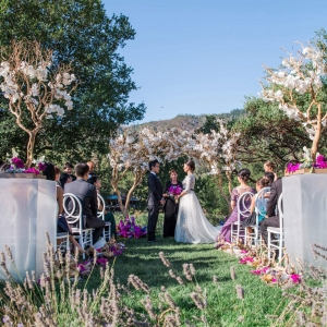 Elegant destination wedding ceremony at Calistoga Ranch by destination wedding planner Mango Muse Events