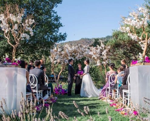 Elegant destination wedding ceremony at Calistoga Ranch by destination wedding planner Mango Muse Events