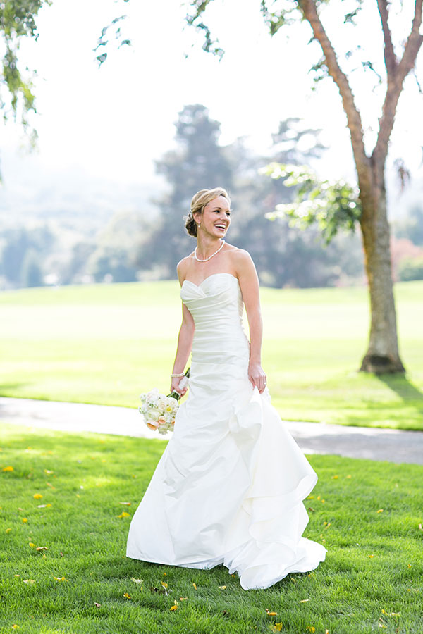 Happy bride at her Carmel wedding by destination wedding planner Mango Muse Events