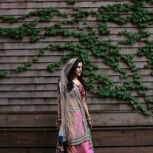 Bride in a sari wedding dress for an Indian wedding at Calistoga Ranch by destination wedding planner, Mango Muse Events