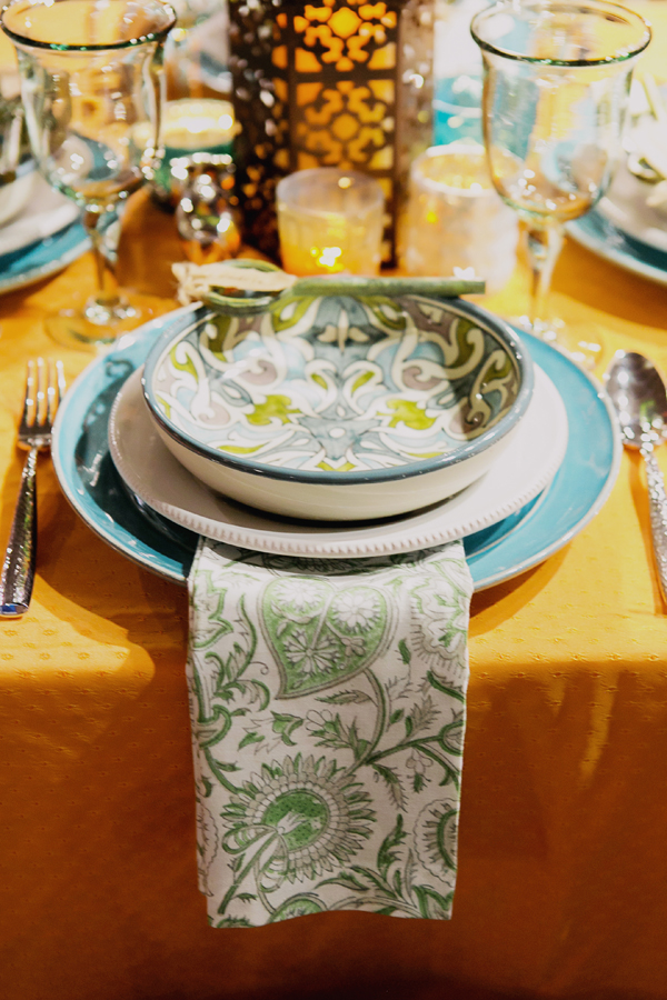 Mis-matched printed napkins for an eclectic global boho wedding table design for Pottery Barn by destination wedding planner Mango Muse Events