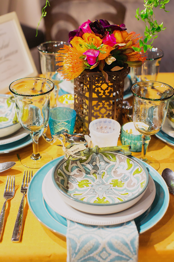 Mixed china in blues and greens create an eclectic global bohemian wedding table design for Pottery Barn by destination wedding planner Mango Muse Events