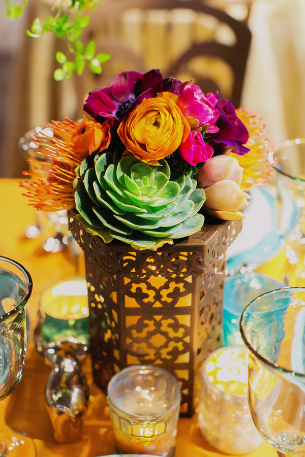 Simple colorful candle floral centerpiece with succulents for an eclectic global bohemian wedding table design for Pottery Barn by destination wedding planner Mango Muse Events