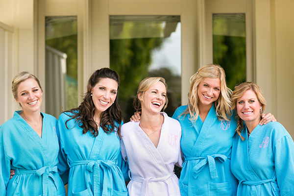 Bride and bridesmaids getting ready and laughing at a destination wedding in Carmel by Destination wedding planner, Mango Muse Events