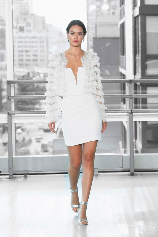 Short modern wedding dress with fringed jacket by Justin Alexander Signature bridal fall 2020 wedding dress trend picked by destination wedding planner Mango Muse Events